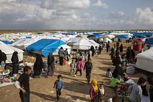 Women and children who fled ISIS' last areas of control in Syria at the Al Hol camp last Thursday. Approximately 67,000 internally displaced people were living in the camp, which has a capacity of 10,000, as of March 14.