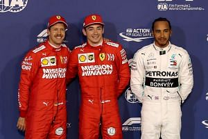 (From left) Vettel, Leclerc and Hamilton pose after the qualifying session.