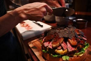 The Golden Giant Burger, painstakingly prepared by chefs at the swanky Oak Door steakhouse in Tokyo's Roppongi district, went on sale on April 1, 2019.