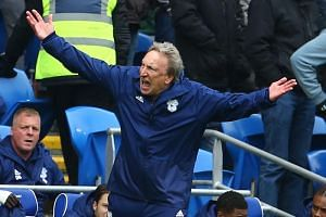 Cardiff City's English manager Neil Warnock gestures on the touchline during the EPL football match between Cardiff City and Chelsea at Cardiff City Stadium in Cardiff, south Wales on March 31, 2019.