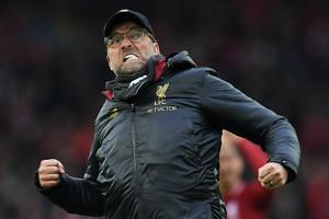 Liverpool's German manager Jurgen Klopp reacts to their victory on the pitch after the EPL football match between Liverpool and Tottenham Hotspur at Anfield in Liverpool, north west England on March 31, 2019.