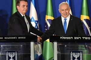 Brazilian President Jair Bolsonaro (left) and Israeli Prime Minister Benjamin Netanyahu shake hands after making joint press statements at the Prime Minister's residence in Jerusalem, on March 31, 2019.