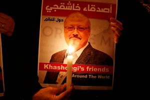 A demonstrator holds a poster with a picture of Saudi journalist Jamal Khashoggi outside the Saudi Arabia consulate in Istanbul, Turkey, on Oct 25, 2018.