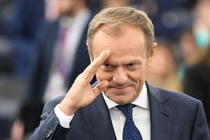 Tusk (above) was reacting to Theresa May's statement that she would seek a further Brexit delay.
