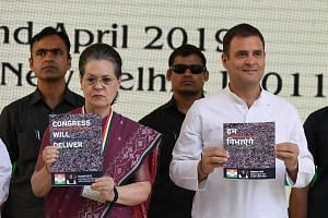 India's Congress party president Rahul Gandhi and his mother, former party president Sonia Gandhi, presenting the election manifesto in New Delhi yesterday.