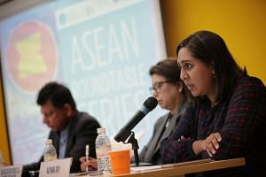 Ms Alpana Roy (right), director of the Asean division at Singapore's Ministry of Trade and Industry, at an Asean roundtable discussion, with Apec Secretariat executive director Rebecca Fatima Sta Maria (centre) and CIMB Asean Research Institute cha