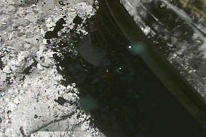 The Hayabusa2 spacecraft landing on the asteroid Ryugu.