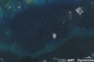 Recent Philippine construction at Thitu Island in the South China Sea, and the fleet of Chinese navy, coast guard, and maritime militia vessels deployed in response.