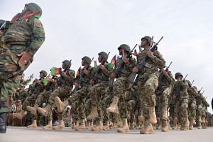 Afghan National Army soldiers march during a military base ceremony in February 2019.