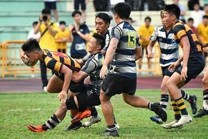 Kaylen Chin (far left) scores a try for ACS(I) in the B division Boys Rugby Final at Queenstown Stadium, on April 4, 2019.