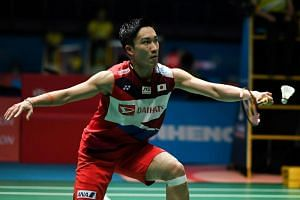 Japan's Kento Momota hits a return against Indonesia's Jonatan Christie (not pictured) during their men's singles match at the Malaysia Open badminton tournament in Kuala Lumpur on April 4, 2019.