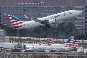 An American Airlines Boeing 737 taking off from Ronald Reagan Washington National Airport on March 11, 2019. The airline said it would extend cancellations of 90 flights a day following the grounding of 737 Max aircraft.