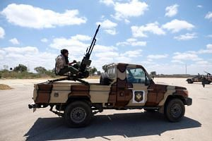 A member of the Libyan National Army heads out of Benghazi to reinforce the troops advancing to Tripoli, in Benghazi, Libya, on April 7, 2019.