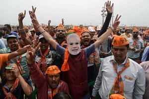 The coalition led by Indian Prime Minister Narendra Modi's Bharatiya Janata Party is expected to win 273 of the 543 Parliament seats at stake, one more than the halfway mark required to rule.