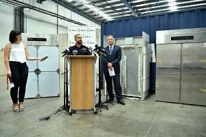 Australian Border Force Superintendent Garry Low (centre) and Organised Crime Squad Detective Assistant Superintendent Damian Beaufils with the fridges used to conceal methylamphetamine during a press conference in Sydney on April 8, 2019.