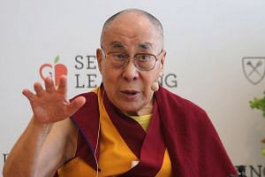 The Dalai Lama speaks during a press conference in New Delhi, India, April 4, 2019.