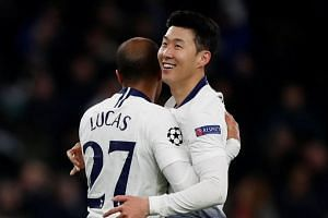 Tottenham's Son Heung-min and Lucas Moura celebrate after the match.