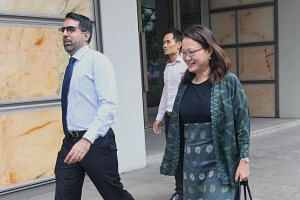 Workers' Party secretary-general Pritam Singh and chairman Sylvia Lim arrive in court, on April 9, 2018.