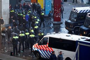 Police and fans outside the stadium before the match.