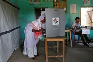 A woman casts her vote at a polling station in Majuli, India, on April 11, 2019.