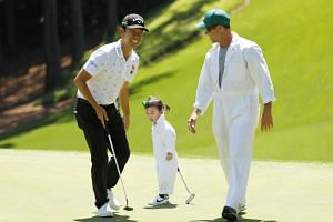 Kevin Na of the United States with his daughter Sophia during the Par 3 Contest prior to the Masters at Augusta National Golf Club in Augusta, Georgia, on April 10, 2019.