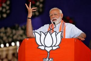 India's PM Narendra Modi addresses an election campaign rally in Junagadh, Gujarat, India, on April 10, 2019.