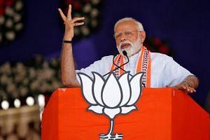 India's PM Narendra Modi addresses an election campaign rally in Junagadh, Gujarat, India, on April 10, 2019.