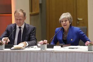 European Council President Donald Tusk (left) and British Prime Minister Theresa May at the start of a special EU summit on Brexit, on April 10, 2019.