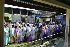 People queueing up to cast their votes at a polling station in Jorhat district of Assam, India, yesterday. Some 142 million are eligible to vote in the first phase of voting, which started yesterday, for 91 out of a total of 543 seats at stake in the