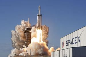 A SpaceX Falcon Heavy rocket, carrying the Arabsat 6A communications satellite, lifts off from the Kennedy Space Center in Cape Canaveral, Florida, US, on April 11, 2019.