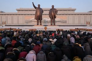 North Koreans bowing to the statues of former leaders Kim Il Sung and Kim Jong Il on Mansu hill in Pyongyang, on Feb 16, 2019.