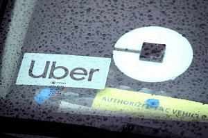 The Uber logo is displayed on a car in March 2019 in San Francisco, California.