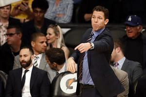 Walton reacts during a game between the Lakers and the Portland Trail Blazers.