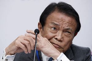 Japan's Taro Aso said the balance of risks to the global economic outlook were skewed to the downside.