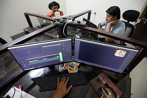 Staff of fact-checking website altnews.in in Ahmedabad checking photos and videos posted on various social media platforms. PHOTO: REUTERS
