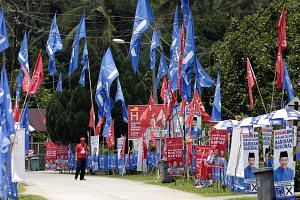 Banners of opposition coalition Barisan Nasional (BN) and of ruling alliance Pakatan Harapan (PH) in Kampung Bemban in Negeri Sembilan this week. Vying for the Rantau seat in today's by-election are BN candidate Mohamad Hasan, PH candidate Streram Si