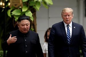 North Korean leader Kim Jong Un (left) and US President Donald Trump talking at the Metropole hotel during their second summit, in Hanoi, Vietnam, on Feb 28, 2019.