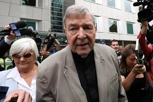 Cardinal George Pell (centre) leaving the County Court of Victoria court on Feb 26, 2019.