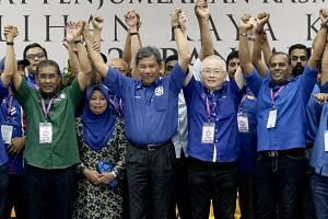Winner of the Rantau state ward Mohamad Hasan (centre), flanked by (from left) Parti Islam SeMalaysia secretary-general Takiyuddin Hassan; Mr Mohamad's wife Raja Salbiah Tengku Nujumuddin; Mr Wee Ka Siong, president of the Malaysian Chinese Associati