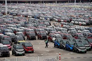 All-electric battery cars in a carpark operated by General Motors and its local joint-venture partners in Liuzhou on Feb 28. China now has 486 electric vehicle manufacturers, more than triple the number from two years ago.