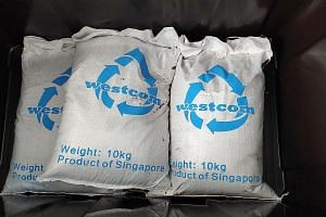 Bags of fertiliser produced by Westcom's food waste recycling machine.