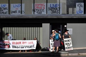 An anti-Adani coal mine protest outside the Liberal National Party headquarters in Brisbane, Australia, on April 1, 2019.