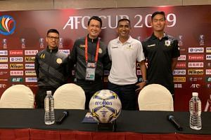 (From left) Nagaworld player Kouch Dani and coach Meas Channa with Tampines Rovers head coach Kadir Yahaya and defender Amirul Adli.