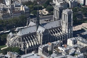 An aerial view of the Notre-Dame Cathedral in Paris, France, in July 2017. Building started in 1163 and finished in 1345.