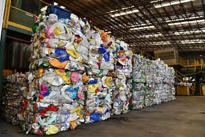 Bales of used plastics at the SembWaste Materials Recovery Facility. About 40 per cent to 50 per cent of waste at the facility is contaminated or not recyclable.