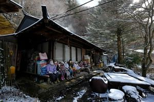 Life-sized dolls sit in the tiny village of Nagoro in western Japan, on March 16, 2019.