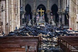 The damaged interior of the Notre Dame Cathedral in Paris, on Tuesday, April 16, 2019.