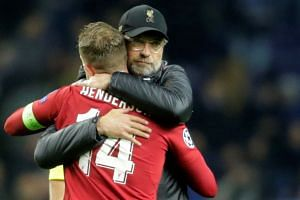Liverpool manager Juergen Klopp celebrates after the match with Jordan Henderson.