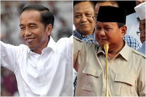"While official results are not due until May 2019, a series of so-called ""quick counts"" by pollsters showed President Joko Widodo (left) between nine and 11 percentage points ahead of presidential candidate Prabowo Subianto on April 18, 2019."