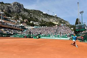 Nice view, nice weather, nice court for Spain's Rafael Nadal, while returning to Bulgaria's Grigor Dimitrov in his 6-4, 6-1 win at the Monte Carlo Masters yesterday. PHOTO: AGENCE FRANCE-PRESSE